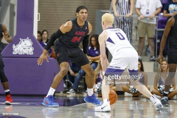 Mustangs forward Everett Ray defends as TCU Horned Frogs guard Jaylen Fisher brings the ball up the court during the college basketball game between...