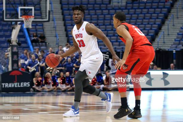 Mustangs forward Semi Ojeleye and Cincinnati Bearcats guard Troy Caupain in action during the first half of the American Athletic Conference...