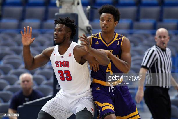 Mustangs forward Semi Ojeleye calls for the ball while defended by East Carolina Pirates guard Elijah Hughes during the first half of the American...