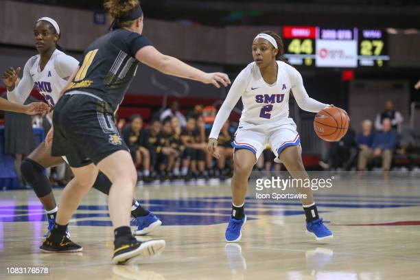 Mustangs guard Ariana Whitfield is guarded by Wichita State Shockers forward Sabrina LozadaCabbage during the game between SMU and Wichita State on...