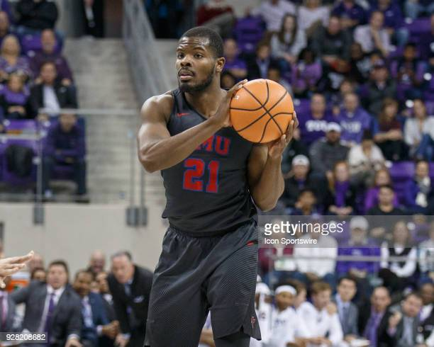 Mustangs guard Ben Emelogu II looks for an open teammate during the college basketball game between the TCU Horned Frogs and the SMU Mustangs on...
