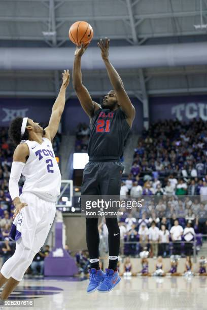 Mustangs guard Ben Emelogu II shoots over TCU Horned Frogs guard Shawn Olden during the college basketball game between the TCU Horned Frogs and the...