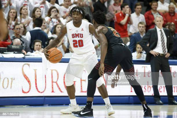Mustangs guard Elijah Landrum dribbles out the clock as USC Trojans guard Jonah Mathews defends during the college basketball game between the SMU...