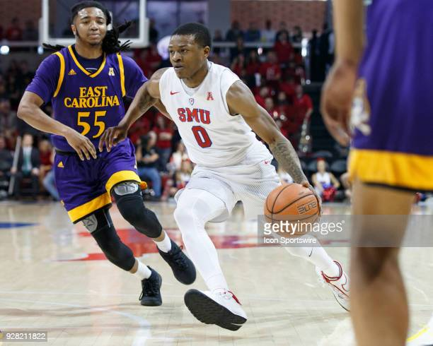 Mustangs guard Jamal McMurray dribbles to the basket as East Carolina Pirates guard Shawn Williams defends during the American Athletic Conference...