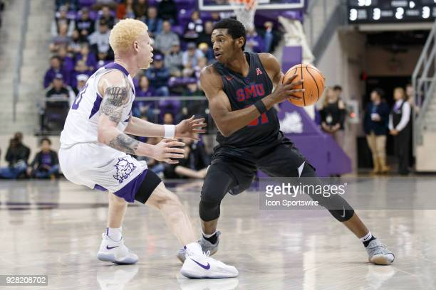 Mustangs guard Jimmy Whitt makes a move as TCU Horned Frogs guard Jaylen Fisher defends during the college basketball game between the TCU Horned...