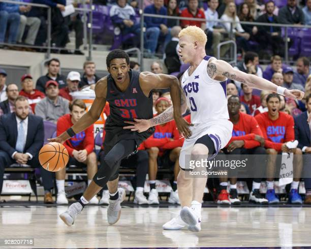 Mustangs guard Jimmy Whitt turns the corner as TCU Horned Frogs guard Jaylen Fisher defends during the college basketball game between the TCU Horned...