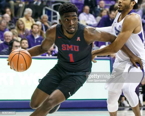 Mustangs guard Shake Milton dribbles around TCU Horned Frogs guard Shawn Olden during the college basketball game between the TCU Horned Frogs and...