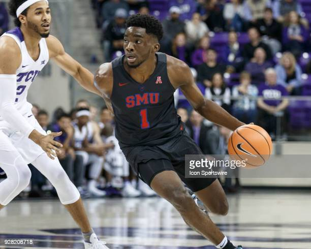 Mustangs guard Shake Milton dribbles as TCU Horned Frogs guard Shawn Olden defends during the college basketball game between the TCU Horned Frogs...