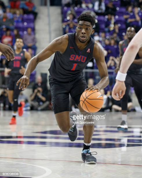 Mustangs guard Shake Milton dribbles up court during the college basketball game between the TCU Horned Frogs and the SMU Mustangs on December 5 at...