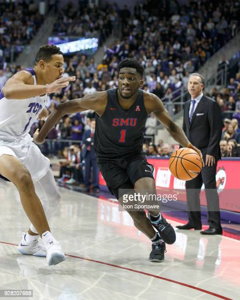 Mustangs guard Shake Milton drives past TCU Horned Frogs guard Desmond Bane during the college basketball game between the TCU Horned Frogs and the...