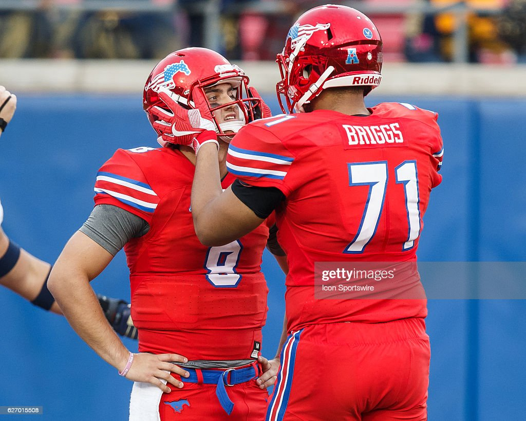 SMU Mustangs offensive lineman Chauncey Briggs (#71) tries to cheer up SMU Mustangs quarterback Ben Hicks (#8) after Hicks threw an interception during the American Athletic Conference college football game between the SMU Mustangs and the Navy Midshipmen on November 26, 2016, at Gerald Ford Stadium in Dallas, TX. Navy won the game 75-31. (Photo by Matthew Visinsky/Icon Sportswire via Getty Images).