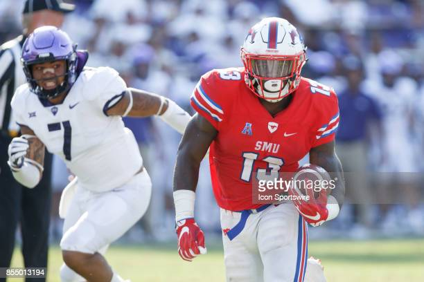 Mustangs running back KeMon Feeman runs up field as TCU Horned Frogs safety Arico Evans closes in during the college football game between the SMU...