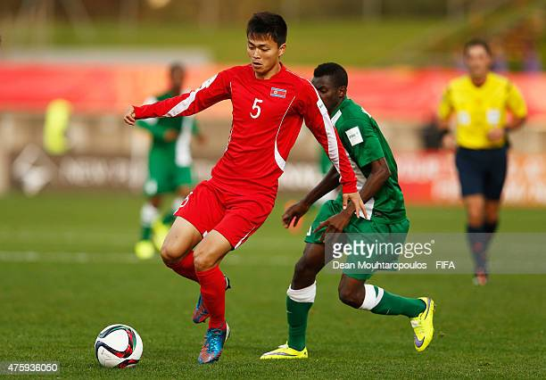 Mustapha Abdullahi of Nigeria and Choe Ju Song of Korea DPR battle for the ball during the FIFA U20 World Cup New Zealand 2015 Group E match between...