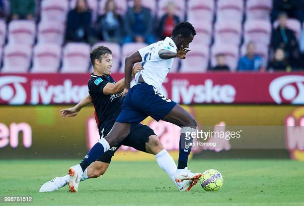 Mustapha Bundu of AGF Aarhus and Erik Sviatchenko of FC Midtjylland compete for the ball during the Danish Superliga match between FC Midtjylland and...