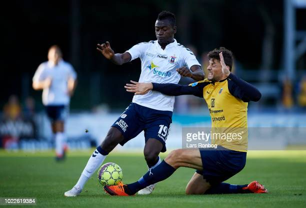 Mustapha Bundu of AGF Aarhus and Rasmus Minor Petersen of Hobro IK compete for the ball during the Danish Superliga match between Hobro IK and AGF...
