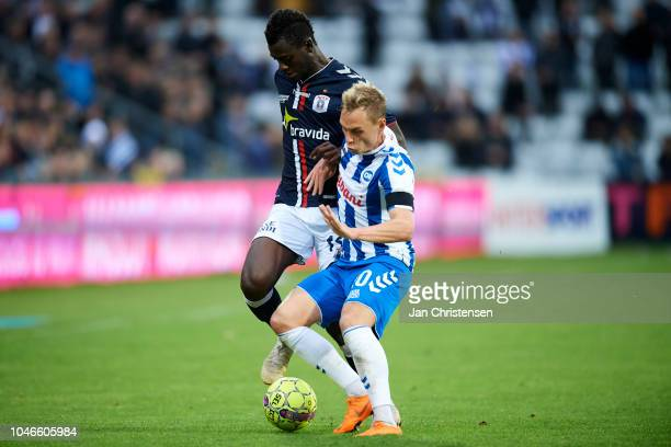 Mustapha Bundu of AGF Arhus and Jacob Barrett Laursen of OB Odense compete for the ball during the Danish Superliga match between OB Odense and AGF...