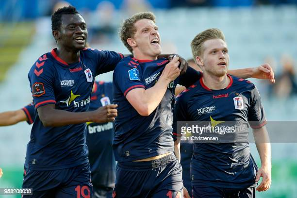 Mustapha Bundu of AGF Arhus Jens Stage of AGF Arhus and Bror Blume of AGF Arhus celebrate the 02 goal from Bror Blume during the Danish Alka...