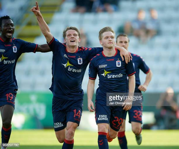 Mustapha Bundu of AGF Arhus Jens Stage of AGF Arhus Bror Blume of AGF Arhus samt Martin Pusic of AGF Arhus celebrates the 02 goal from Bror Blume...