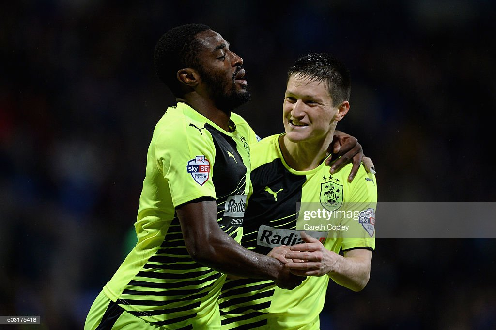 Mustapha Carayol of Huddersfield Town celebrates scoring his team's second goal with Joe Lolley during the Sky Bet Championship match between Bolton Wanderers and Huddersfield Town at the Macron Stadium on January 2, 2016 in Bolton, United Kingdom.