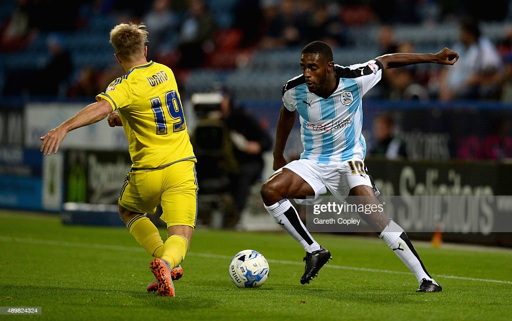 Mustapha Carayol of Huddersfield Town looks to get past Jamie Ward of Nottingham Forest during the Sky Bet Championship match between Huddersfield Town and Nottingham Forest at John Smiths Stadium on September 24, 2015 in Huddersfield, England.
