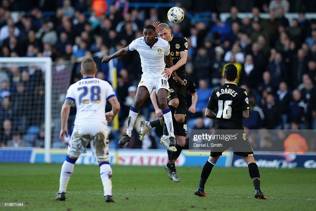 Mustapha Carayol of Leeds United FC and Dean Moxey of Bolton Wanderers FC comepte for the ball during the Sky Bet Championship League match between Leeds United and Bolton Wanderers, at Elland Road Stadium on March 5, 2016 in Leeds, United Kingdom.