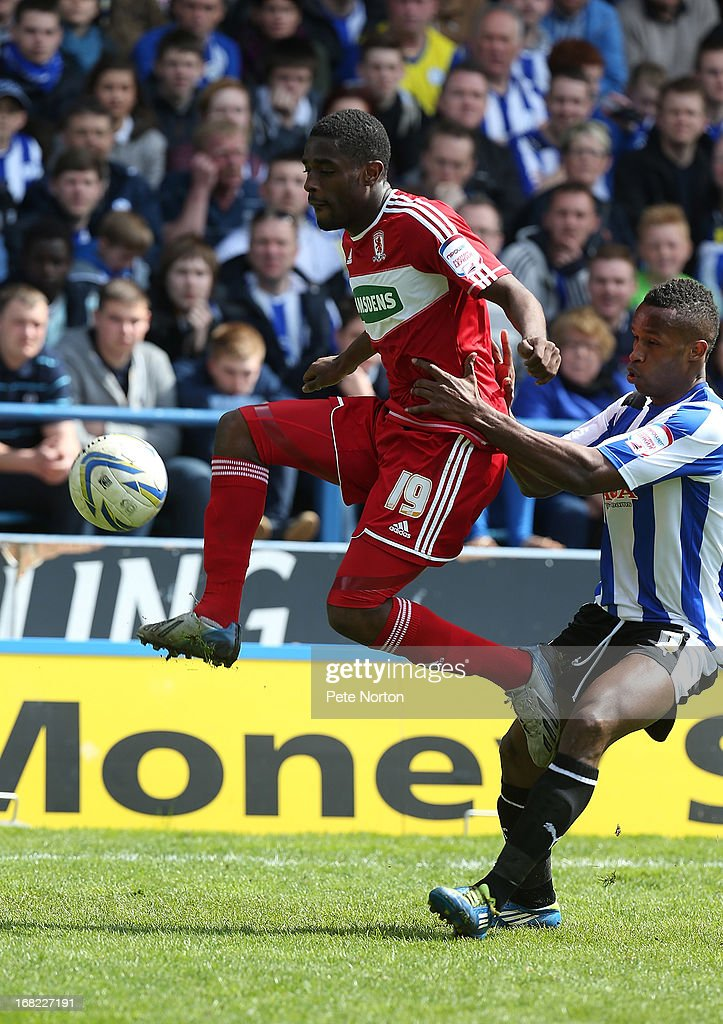 Mustapha Carayol of Middlesbrough attempts to control the ball under pressure from Gary Madine of Sheffield Wednesday during the npower Championship match between Sheffield Wednesday and Middlesbrough at Hillsborough Stadium on May 4, 2013 in Sheffield, England.