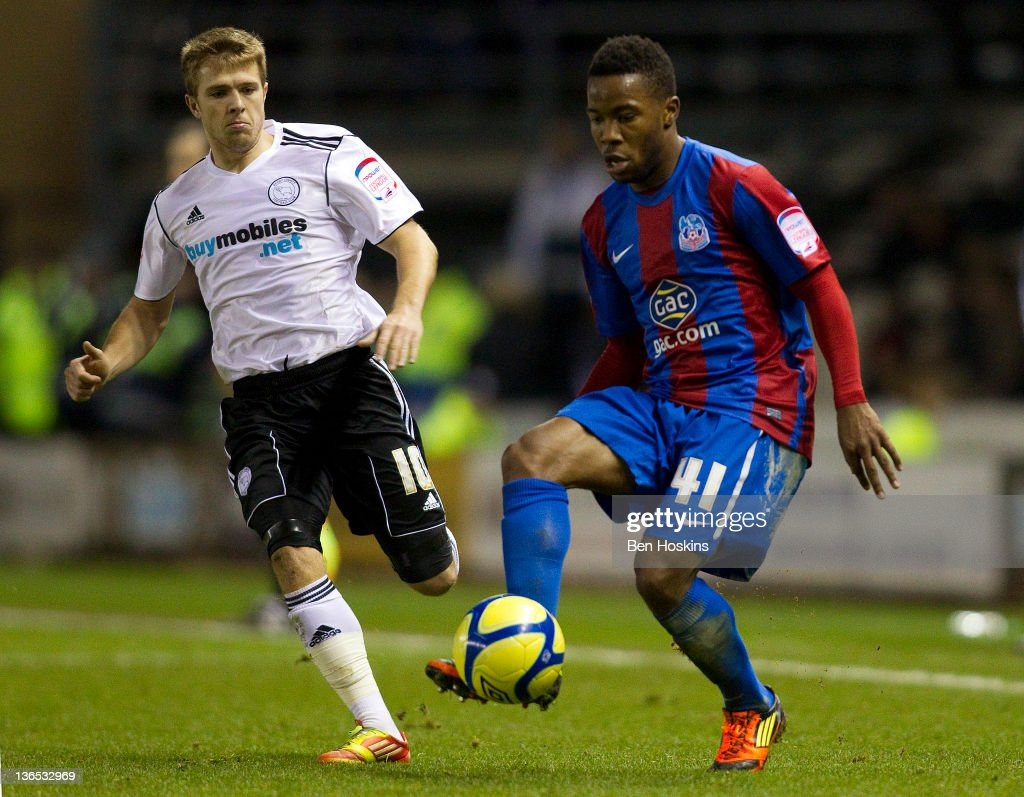 Mustapha Dumbuya of Crystal Palace passes under pressure from Jamie Ward of Derby during the FA Cup sponsored by Budweiser Third Round match between Derby County FC and Crystal Palace FC at Pride Park on January 7, 2012 in Derby, England.
