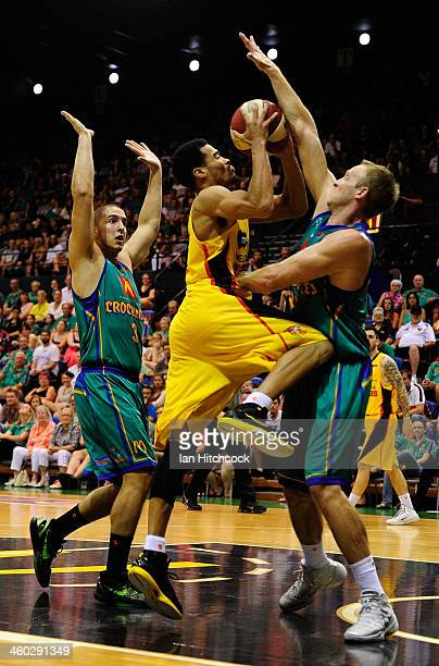 Mustapha Farrakhan of the Tigers attempts a layup over Jacob Holmes of the Crocodiles during the round 12 NBL match between the Townsville Crocodiles...