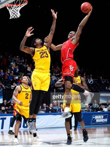 Mustapha Heron of the St John's Red Storm drives to the basket against Romello White of the Arizona State Sun Devils during the second half in the...