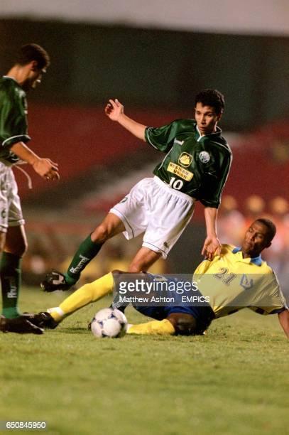 Mustapha Moustaoudia of Raja Casablanca gets the ball past AlNassr's Hadi Sharify