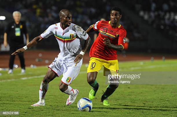 Mustapha Yatabare of Mali vies for the ball against Kevin Constant of Guinea during the Africa Cup of Nations Group D soccer match between Guinea and...