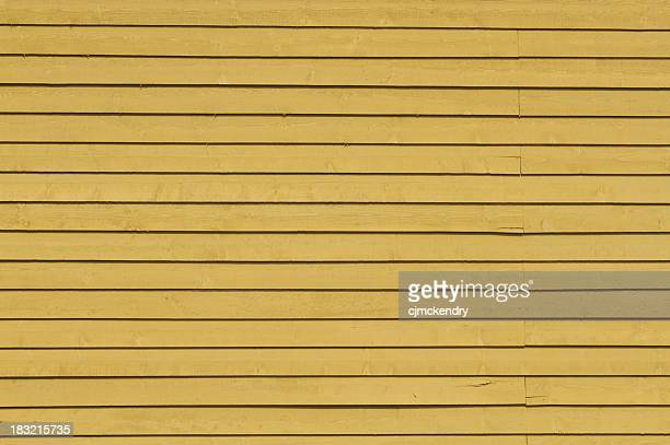 mustard yellow wooden siding