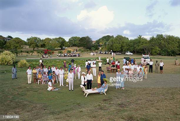 Mustique group 1993 Princess Margaret sitting in front of Viscount and Viscountess Linley homeowners staff and local residents Mustique West Indies...