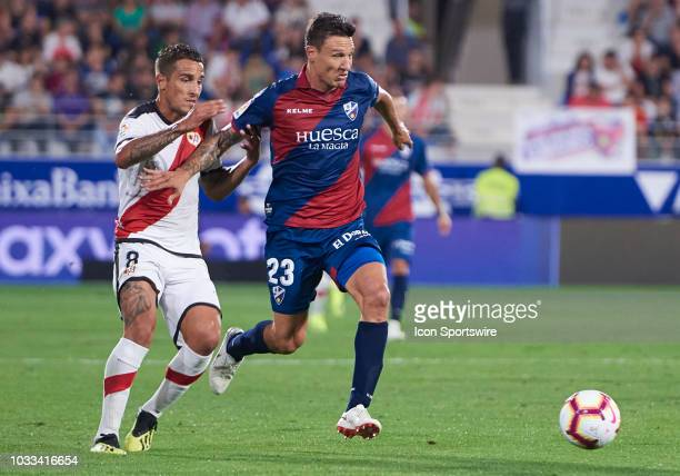 Musto midfielder of SD Huesca competes for the ball with Trejo midfielder of Rayo Vallecano de Madrid during the La Liga game between SD Huesca and...