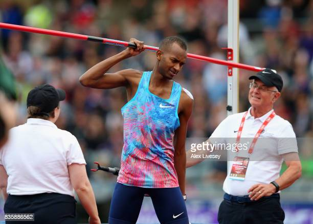 Mutaz Essa Barshim of Qatar celebrates making the highest jump of the year by claiming and walking off with the crossbar during the Muller Grand Prix...