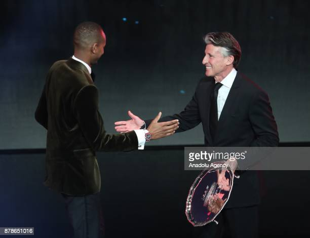 Mutaz Essa Barshim of Qatar receives trophy as from Male Athlete of the Year from IAAF President Sebastian Coe during the IAAF Athletics Awards 2017...