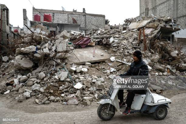 Mute 17yearold Syrian Adnan who lost both legs in 2014 following an airstrike as he was walking towards his father's store from school rides a...