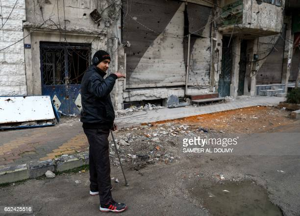Mute 17-year-old Syrian Adnan, who lost both legs in 2014 following an airstrike as he was walking towards his father's store from school, stands...