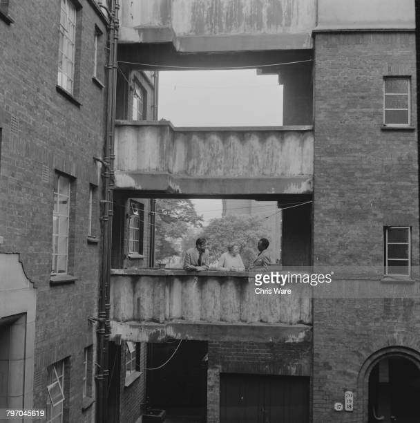 Mutesa II Kabaka of Buganda and his old army friend Major Richard Carr Gomm talking to a local resident in Bermondsey London July 1968 The Kabaka is...
