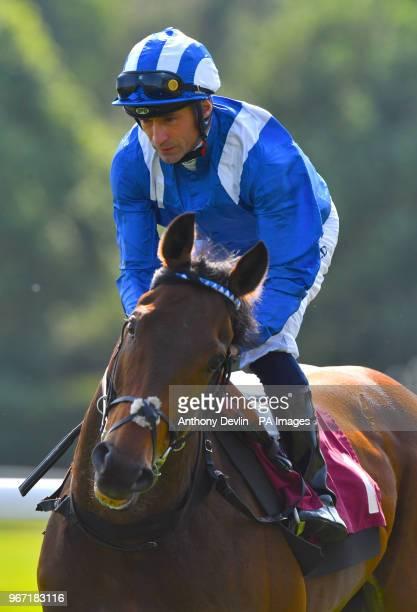 Muthmir ridden by jockey James Doyle