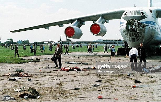Mutilated bodies lie on the tarmac after an Su-27 fighter plane crashed into the crowd of spectators at an air show July 27, 2002 in Lviv, Ukraine....