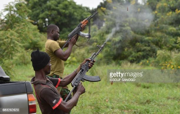 Mutinous soldiers fire in the air inside a military camp in the Ivory Coast's central second city Bouake, on May 15, 2017. Gunshots rang out early on...