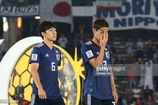 Muto Yoshinori and Endo Wataru of Japan show their dejection after the AFC Asian Cup final match between Japan and Qatar at Zayed Sports City Stadium...