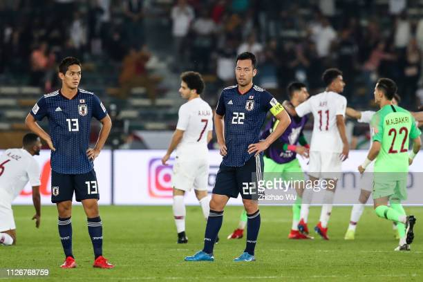 Muto Yoshinori and Yoshida Maya of Japan show their dejection after the AFC Asian Cup final match between Japan and Qatar at Zayed Sports City...