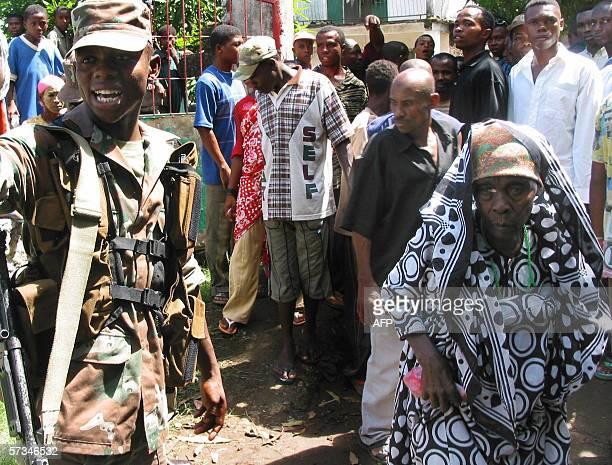 A South African soldier of the African Union mission for the securization of the Comoros directs voters 16 April 2006 at a polling station in...