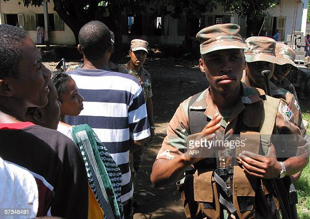 South African soldiers of the African Union mission for the securization of the Comoros patrol 16 April 2006 in the streets of Mutsamudu the capital...