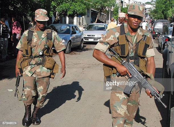 South African soldiers of the African Union mission for the securization of the Comoros patrol 16 April 2006 in Mutsamudu the capital of the Anjouan...