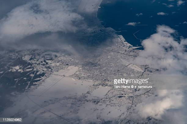 Mutsu Bay and Aomori city in Aomori prefecture in Japan daytime aerial view from airplane