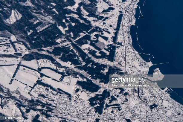 Mutsu Bay and Noheji town in Aomori prefecture in Japan daytime aerial view from airplane