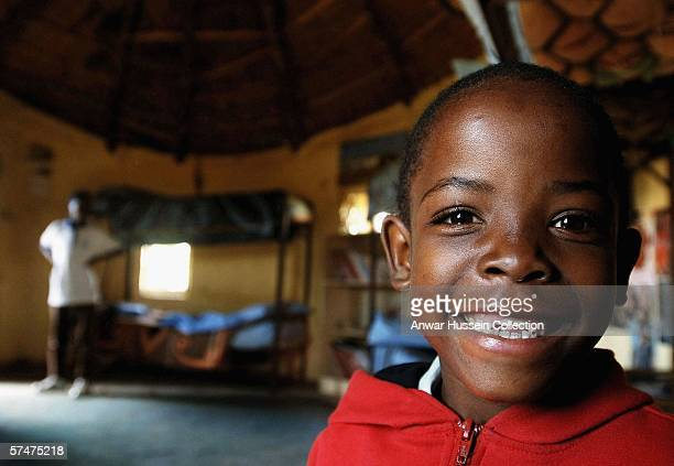Mutsu Potsane waits in his bedroom at the Mants'ase children's home, for Prince Harry to arrive on a return visit to Lesotho on April 24, 2006 in...